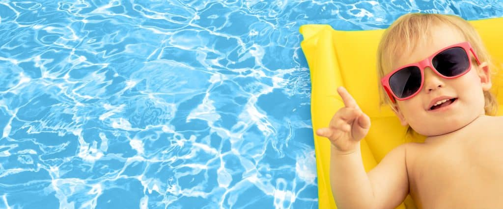 Child on a swimming pool float